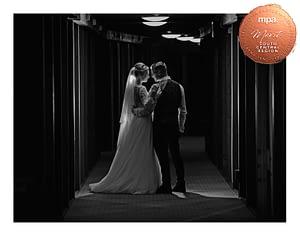 bride and groom in hotel corridor at night