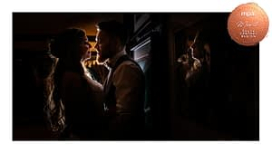 bride and groom at night indoors with reflection