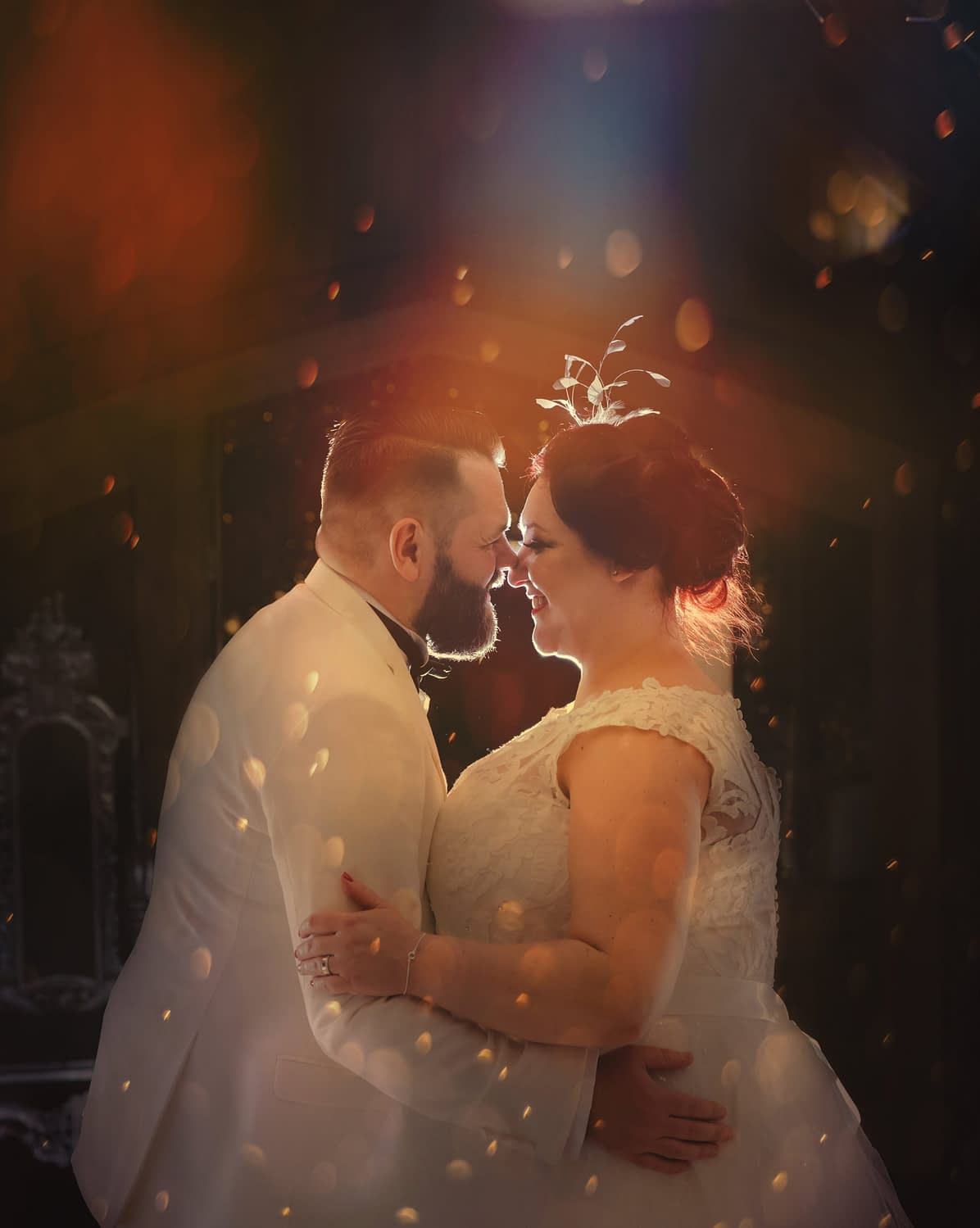 bride and groom standing together with coloured lighting