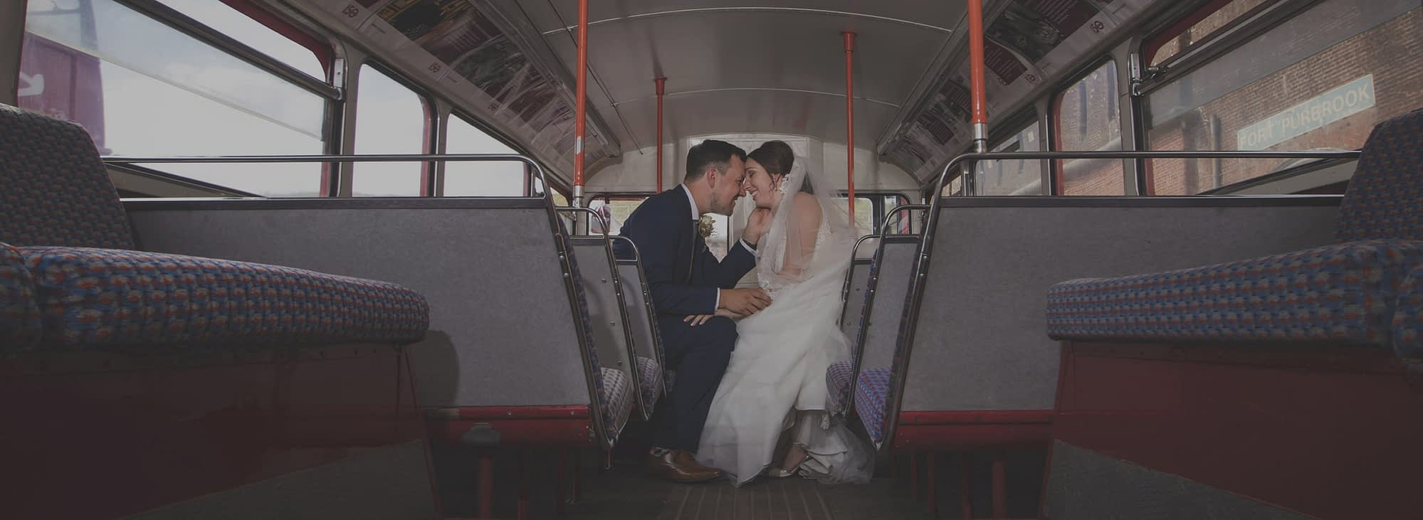 couple kissing on bus