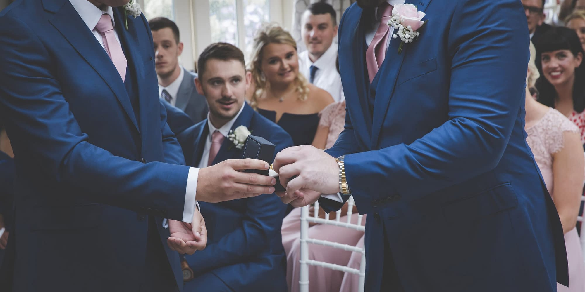 groom takes bride's ring from best man