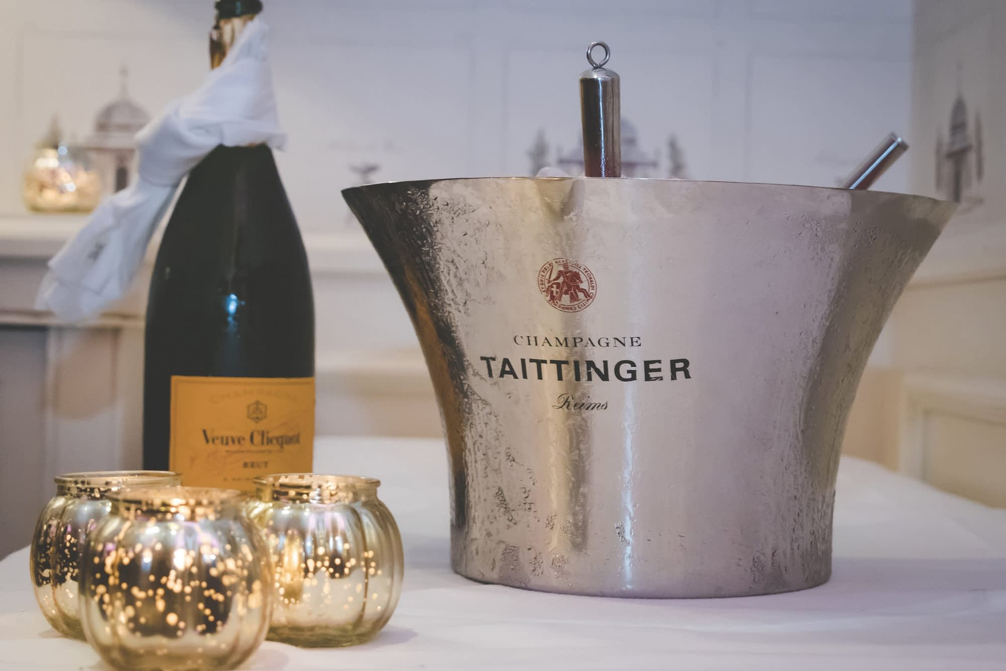 bottle of Champagne and cooler on a table