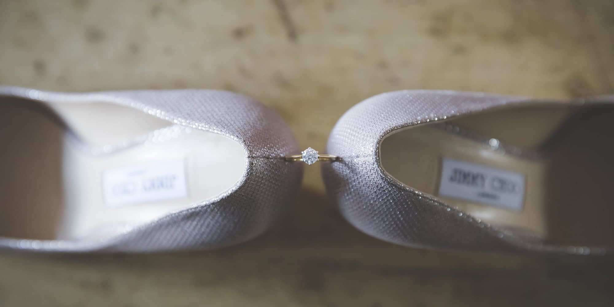 engagement ring balanced on shoe