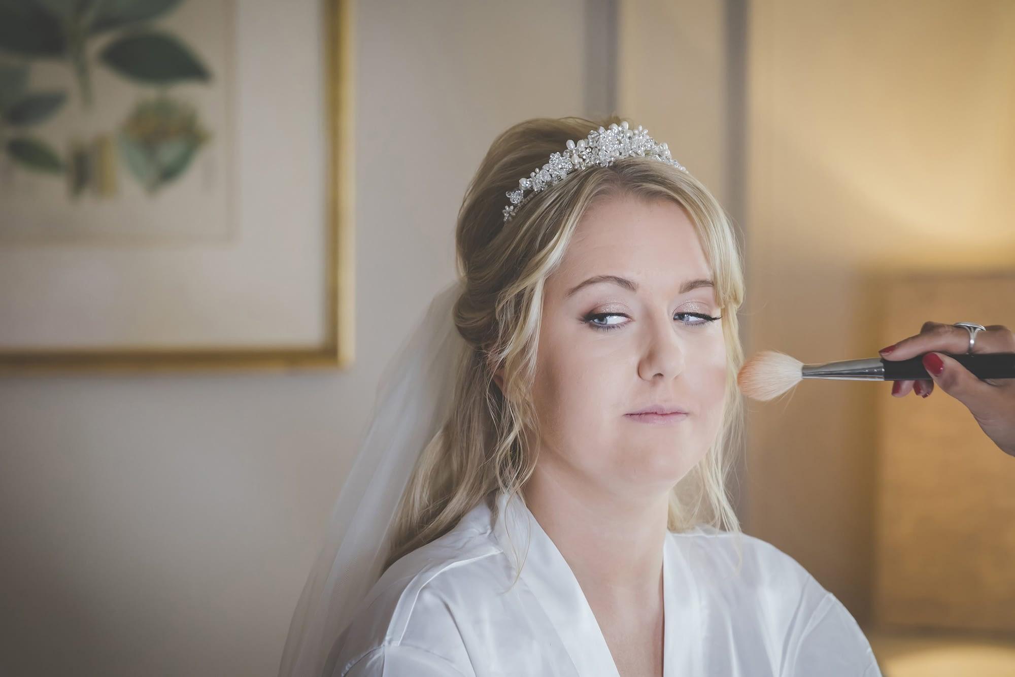 close up of bride having makeup applied