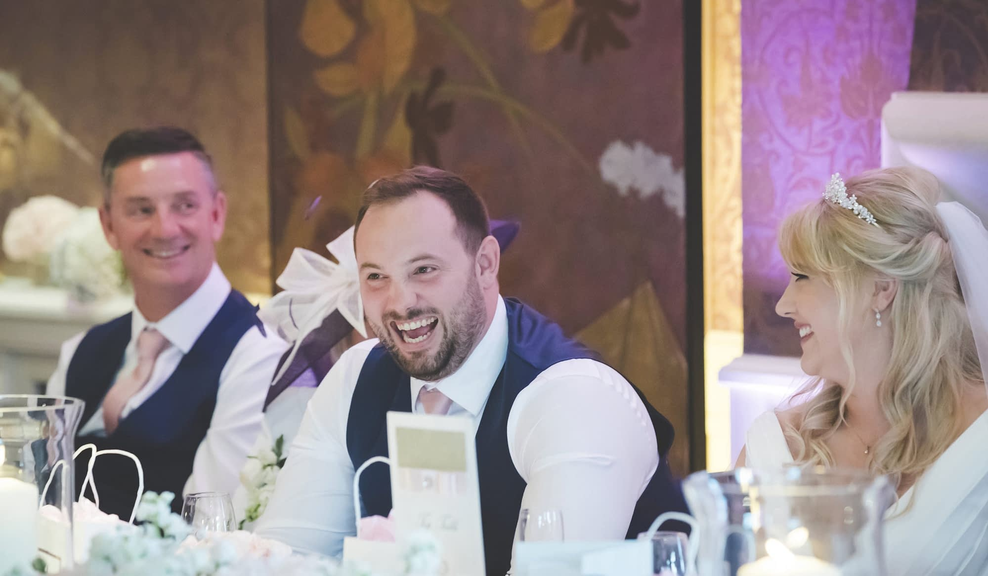 groom laughing sat at table