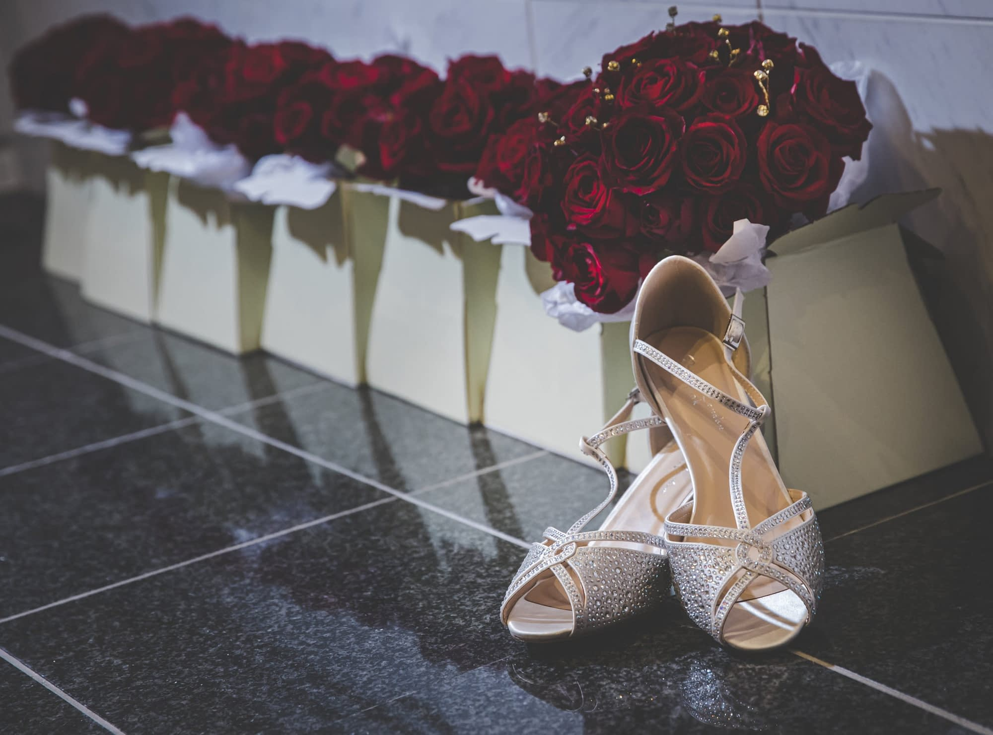 bride's shoes and bouquets