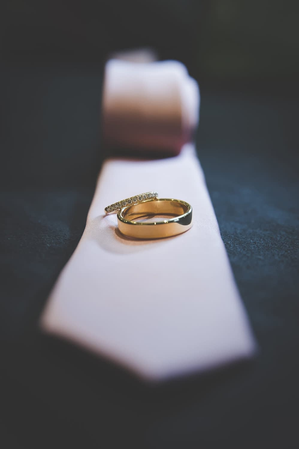 gold wedding rings on a pink tie