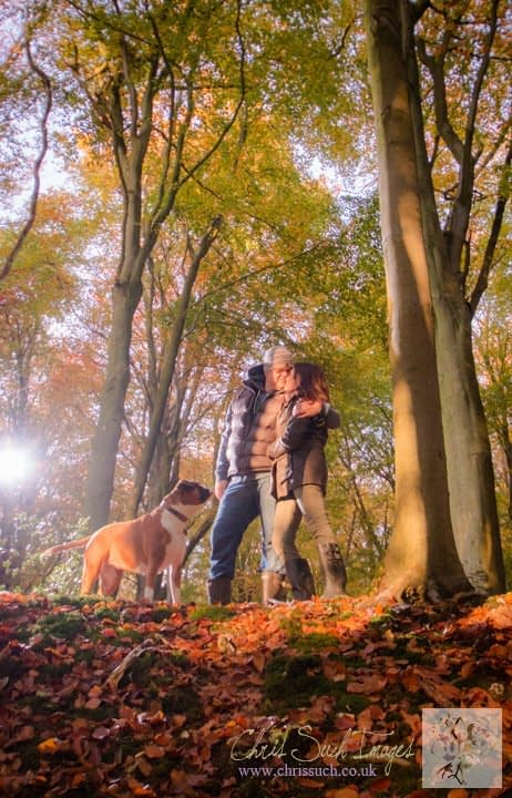 couple with dog in woods