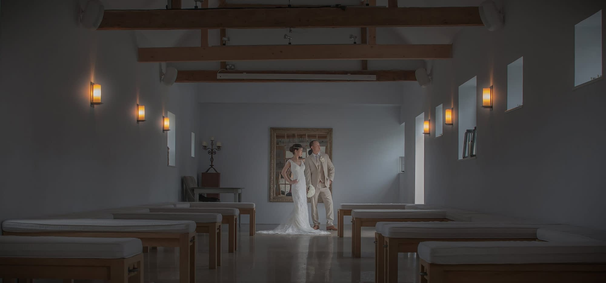couple standing together inside with lights on