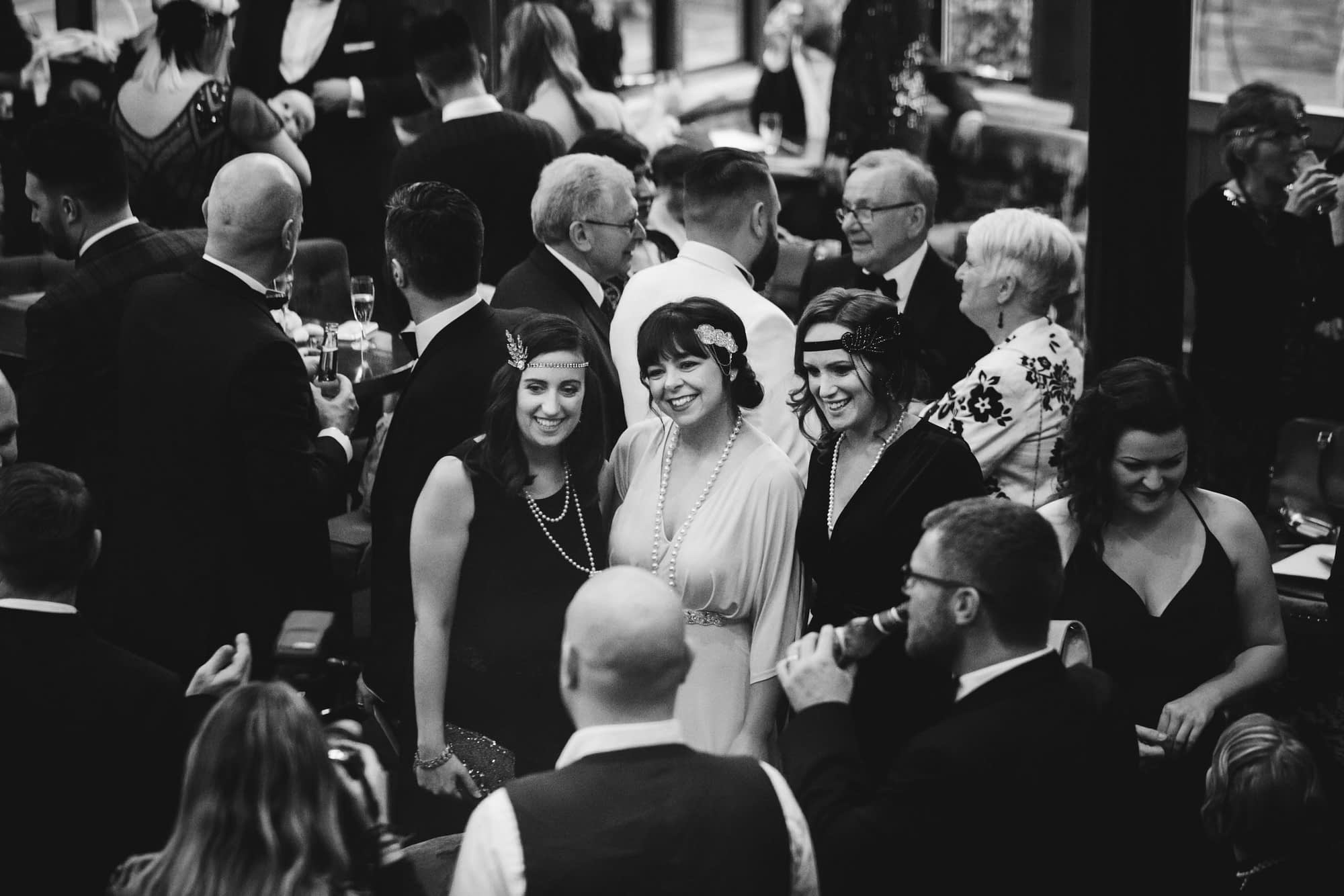 black and white picture of wedding guests