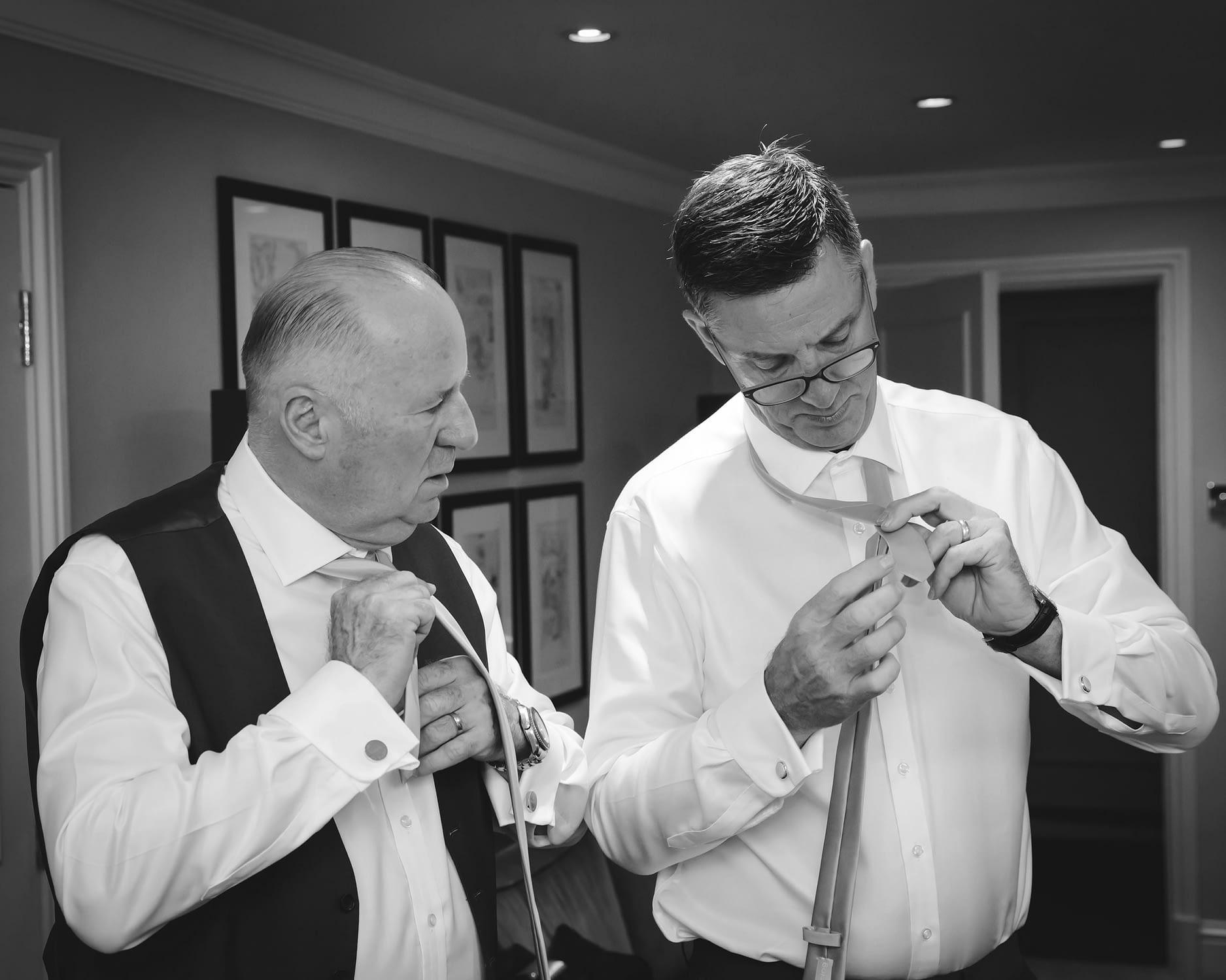 two men tying ties