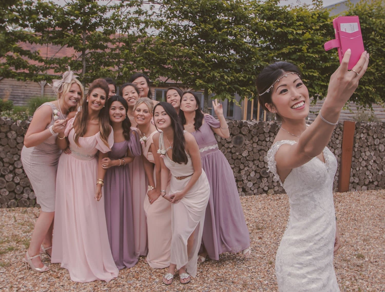 bridesmaids taking a wedding selfie