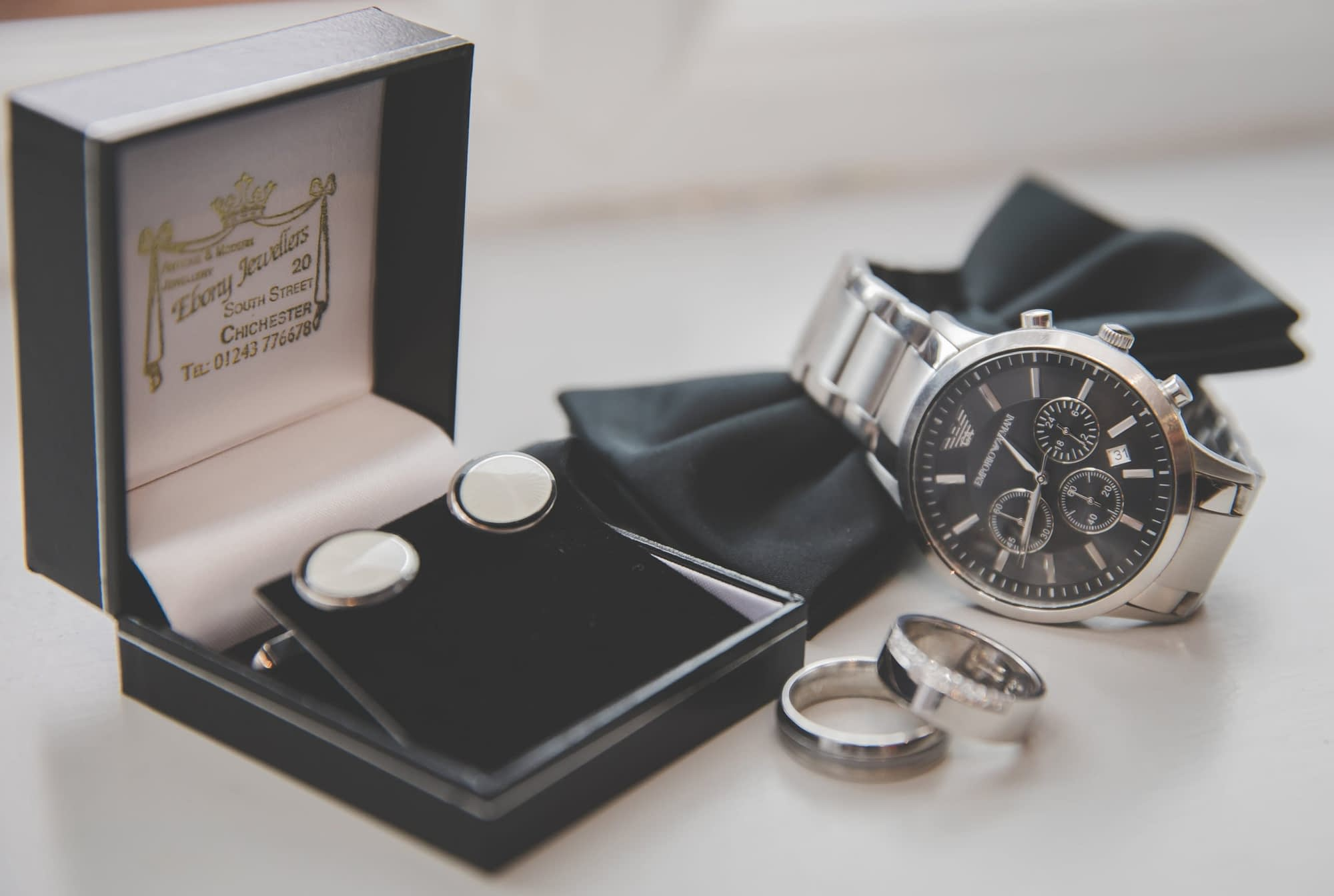 groom's cufflinks, rings and watch