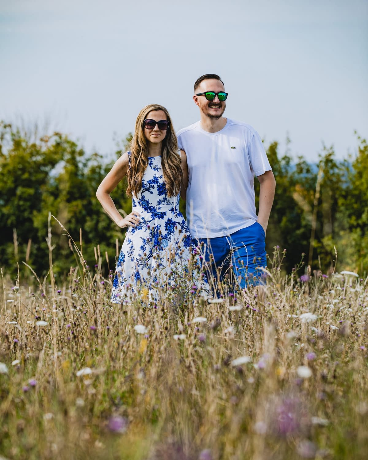 couple standing in long grass