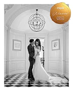 young couple standing together in a stately home corridor