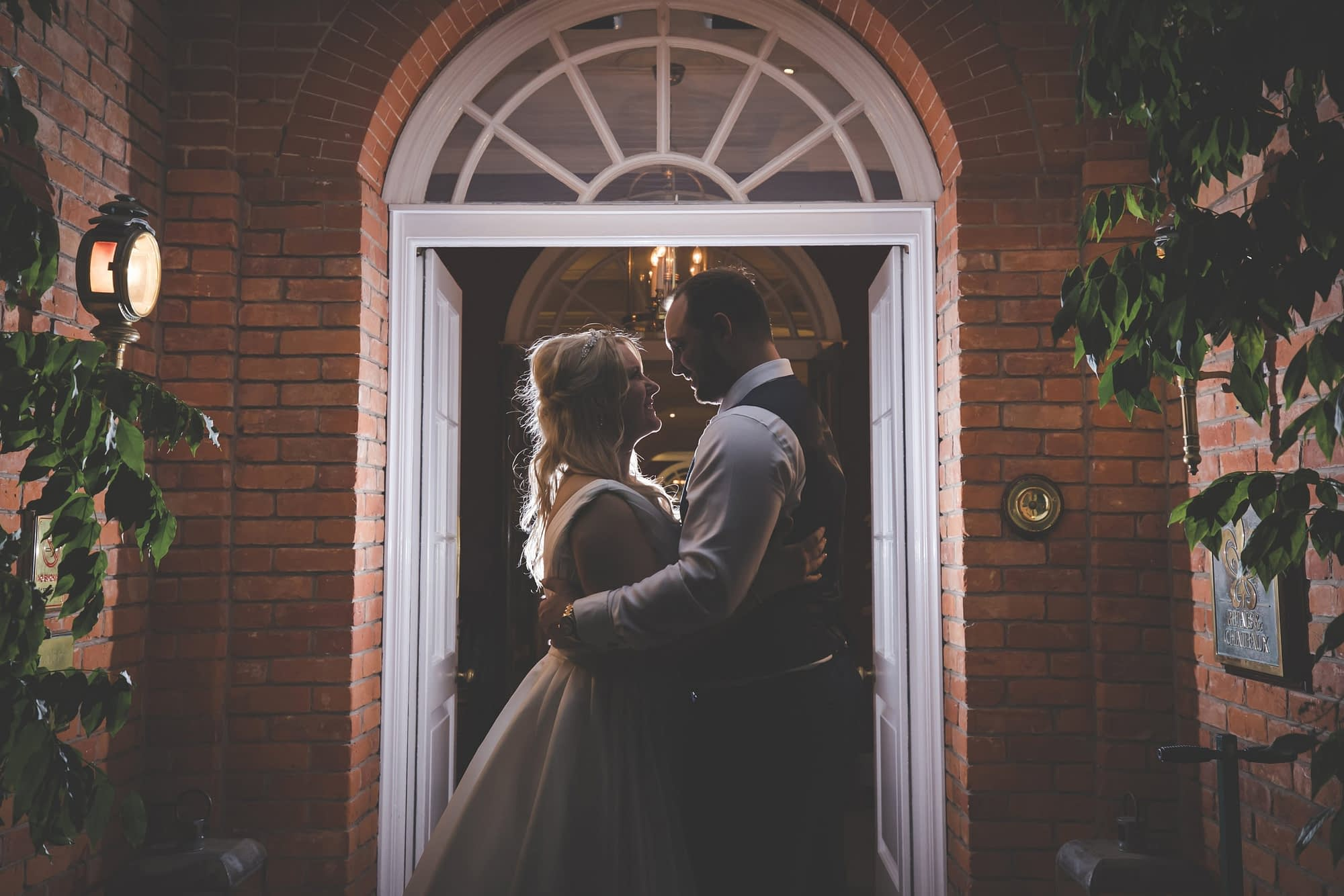 couple standing together in a doorway