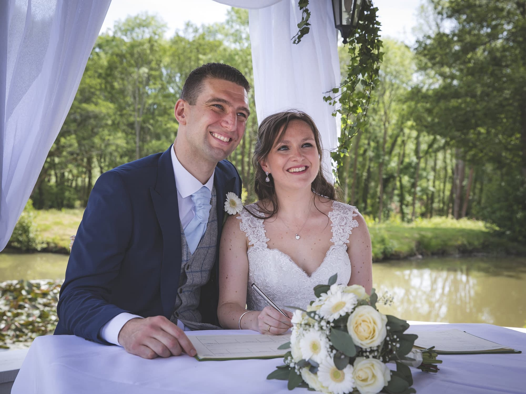 couple smiling with wedding register