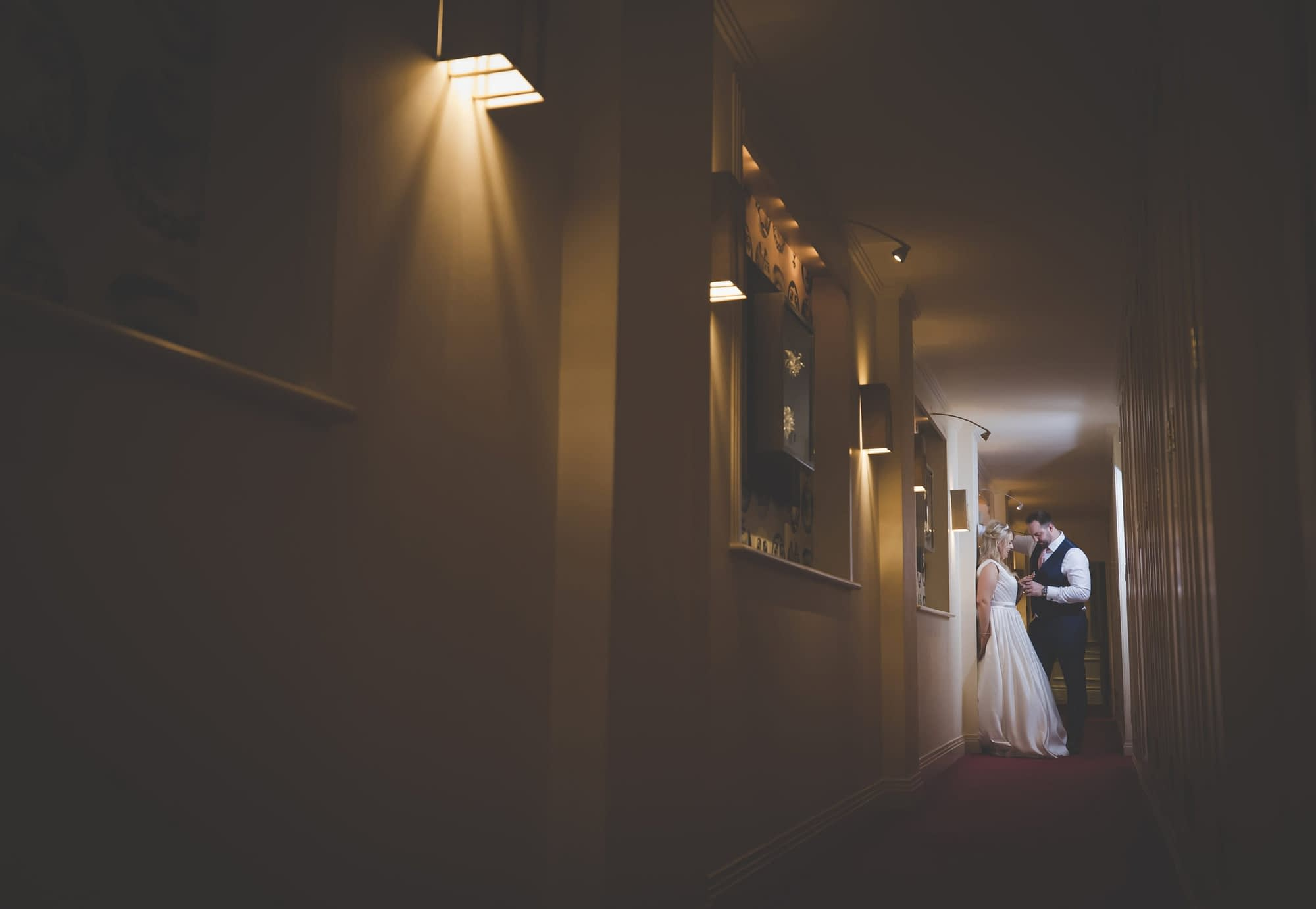 couple standing together in hotel corridor