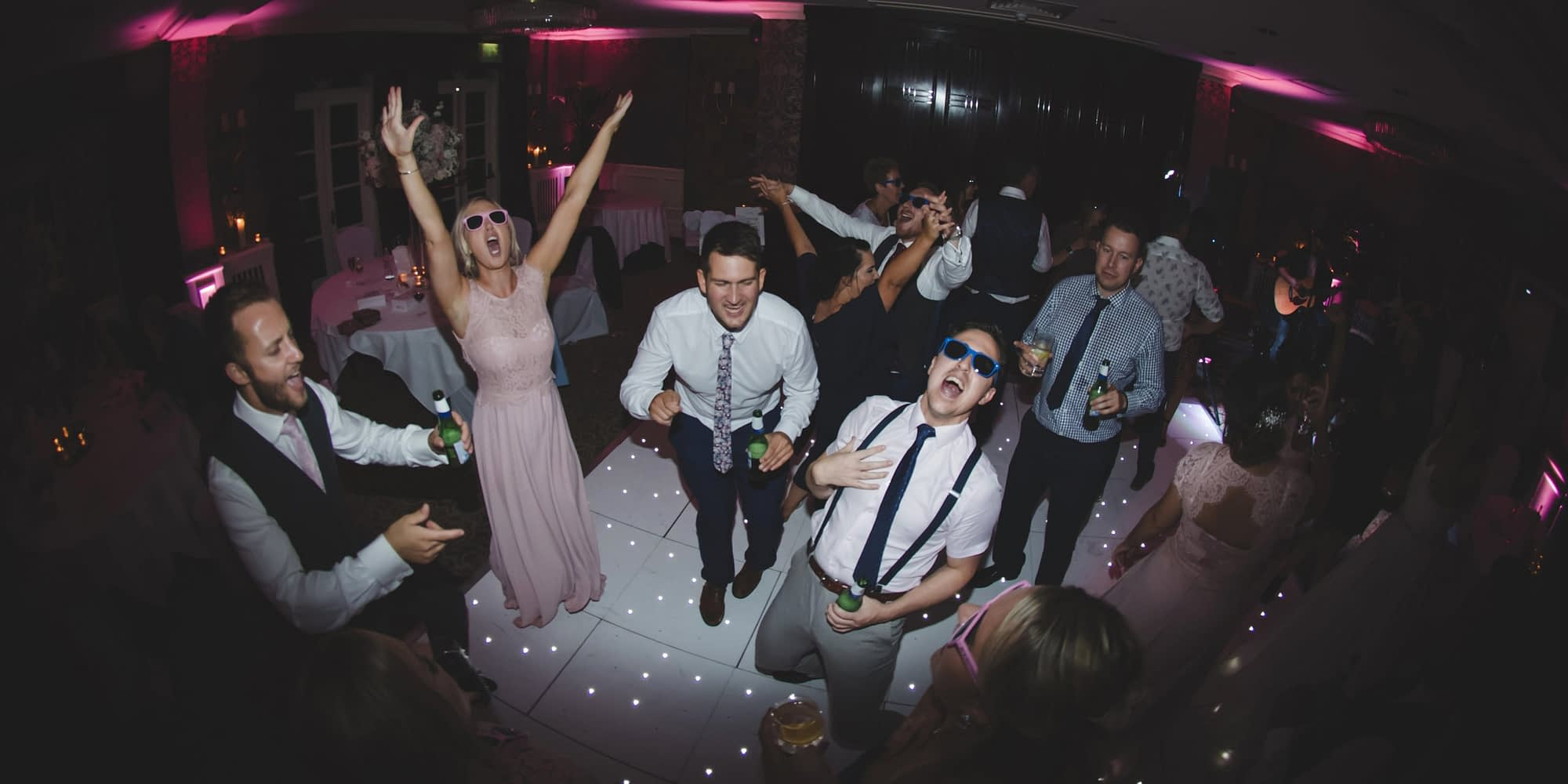 wedding guests dancing in the evening
