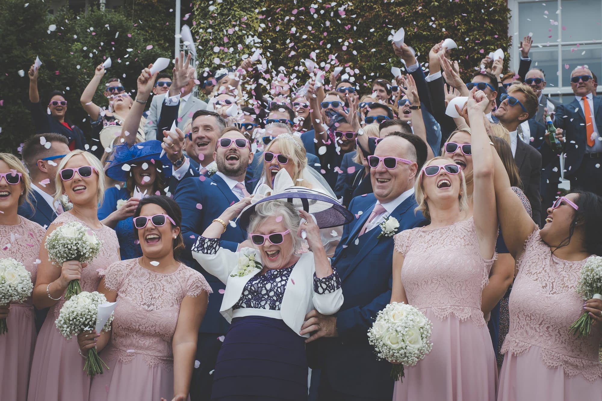 wedding group throws confetti