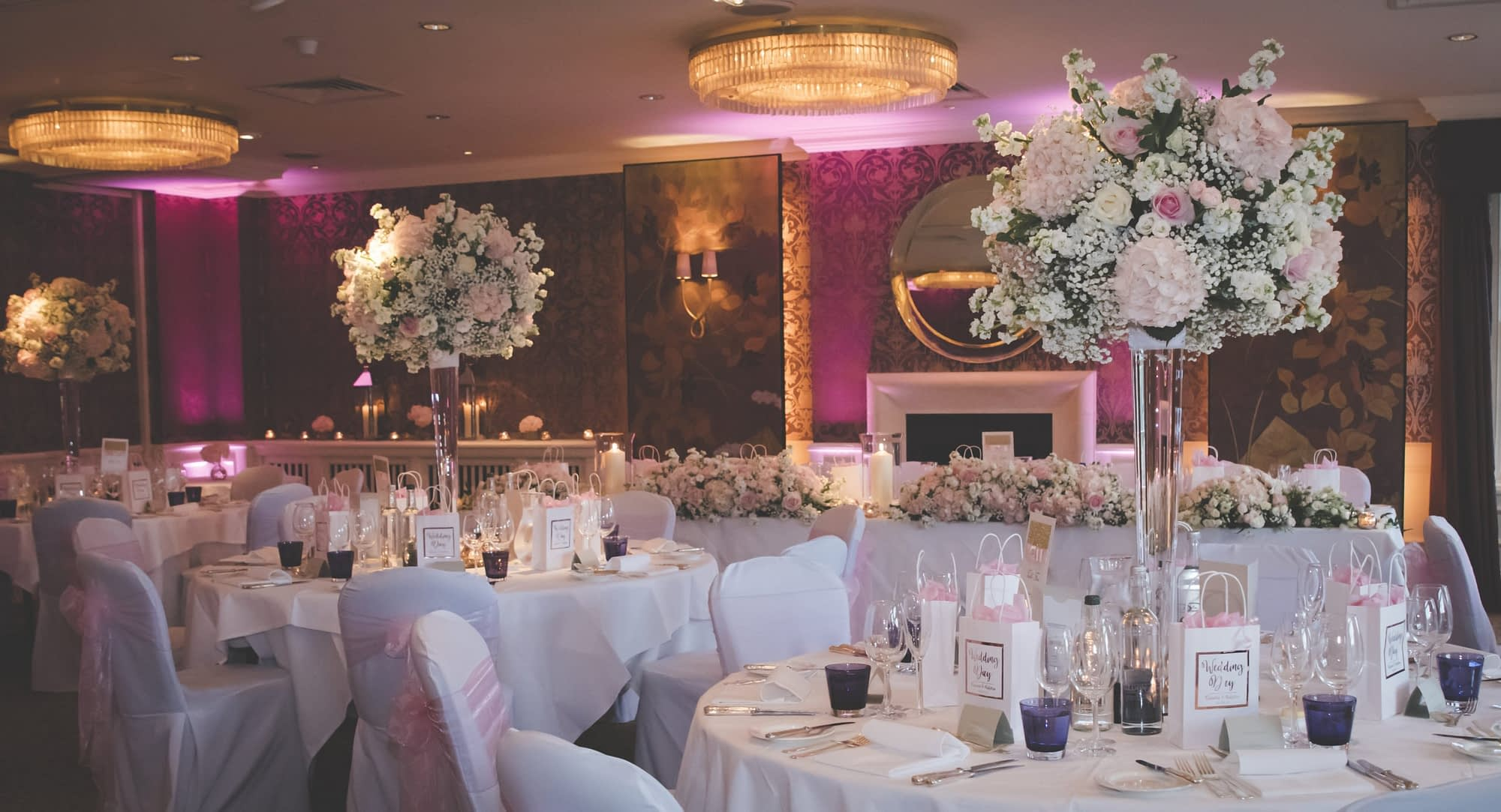wedding reception room decorated with flowers