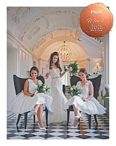 bride and bridesmaids in stately home corridor