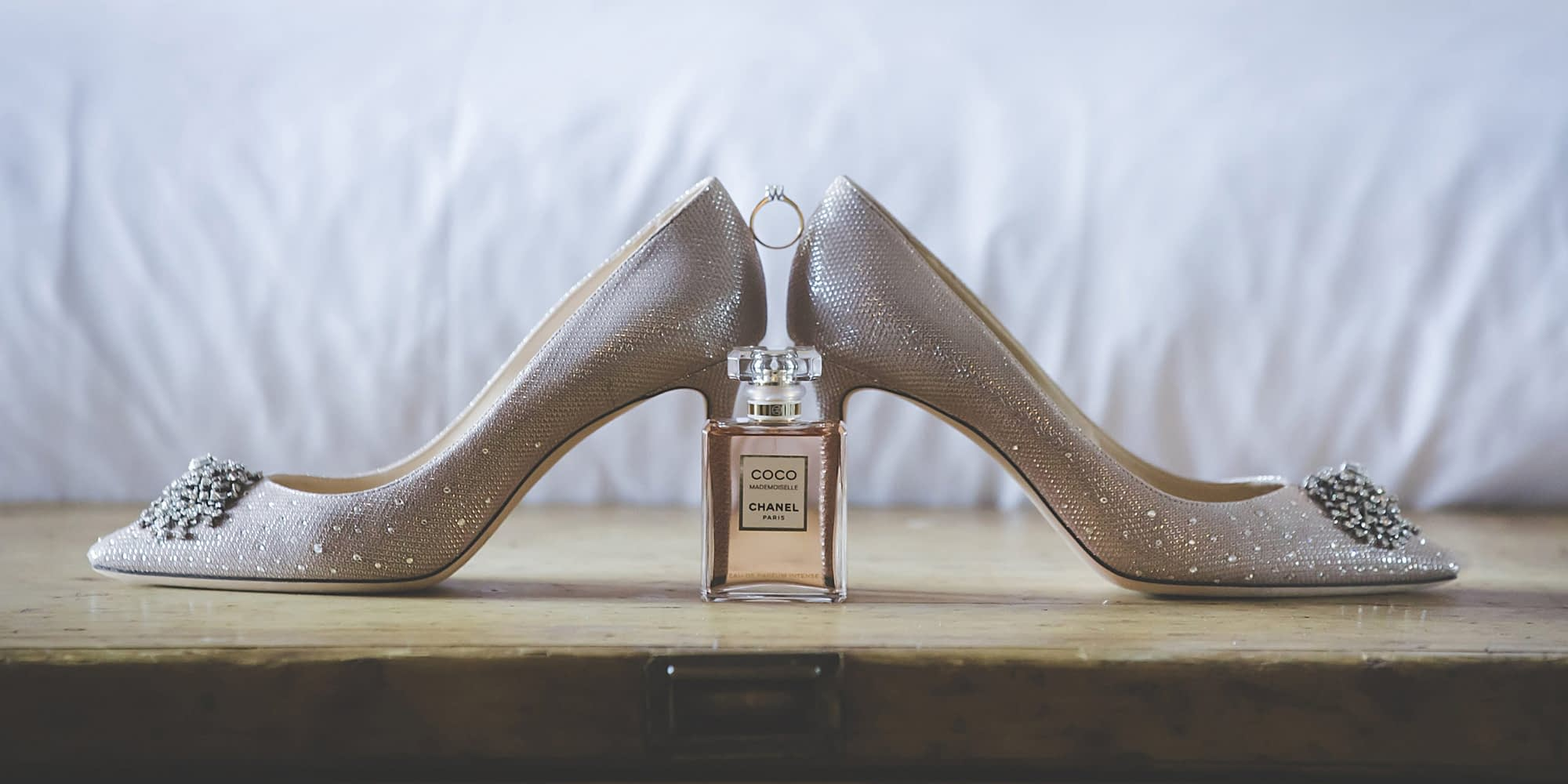 Jimmy Choo shoes & Channel perfume on a table