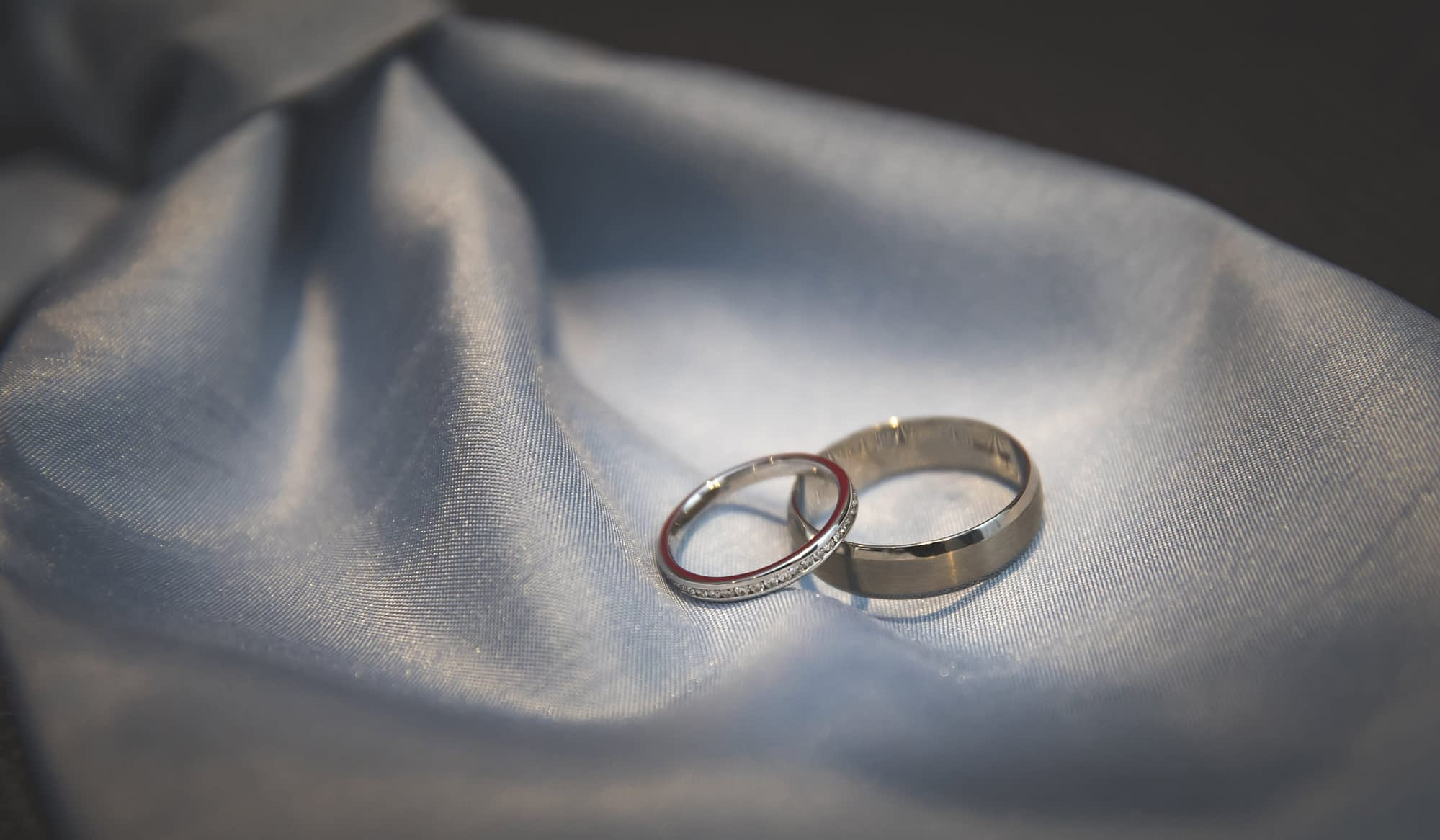 wedding rings on a blue cravat